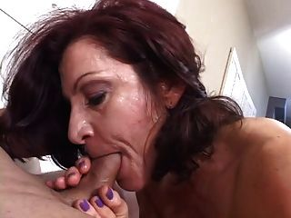 Hot mature brunette masterfully sucks cock while smoking a cigarette 3